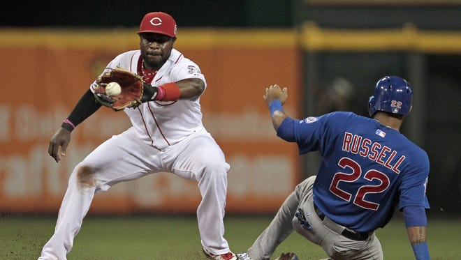 Cincinnati Reds second baseman Brandon Phillips (4) catches a throw as Chicago Cubs second baseman Addison Russell (22) slides safely into second in the fourth inning of the MLB game between the Cincinnati Reds and the Chicago Cubs at Great American Ball Park in Cincinnati on Sept. 30, 2015.