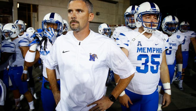 University of Memphis head coach Mike Norvell prepares to take the field against University of Cincinnati in Cincinnati, Ohio.