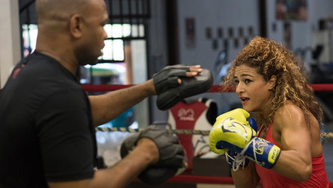 Ikram Kerwat trains with Roy Jones Jr. on Thursday in Cantonment ahead of her ninth professional bout. Kerwat, a 33-year-old model-turned-boxer is preparing for Saturday night's Island Fights 42 at the Pensacola Bay Center.