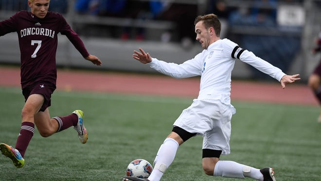 Memorial's Andrew Cross dribbles the ball past a Concordia Lutheran defender in the Class 2A Boys Indiana High School Athletic Association Soccer State Finals at Michael A. Carroll Stadium in Indianapolis Saturday, October 28, 2017.
