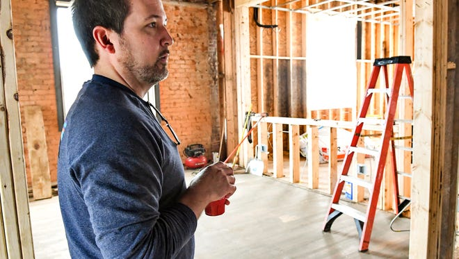 Jason Patterson looks around the upstairs area of a co-working space at 109 South McDuffie Street in Anderson.