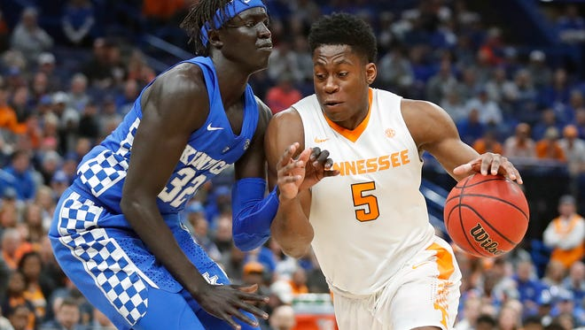 Tennessee forward Admiral Schofield (5) drives against Kentucky's Wenyen Gabriel (32) during the first half of an NCAA college basketball championship game at the Southeastern Conference tournament Sunday, March 11, 2018, in St. Louis. (AP Photo/Jeff Roberson)