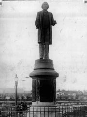 The statue of Frederick Douglass, located at Highland Park Bowl, was originally placed at Central Ave. and St. Paul Street in 1899. City moved it to Highland Park in 1941. (4/2/1928)