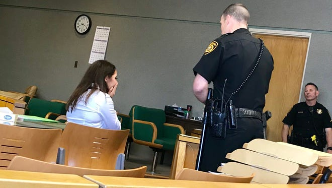 Jacqueline Herron reacts after being sentenced to 11 years and eight months in prison for having sex with two 16-year-old boys she counseled.