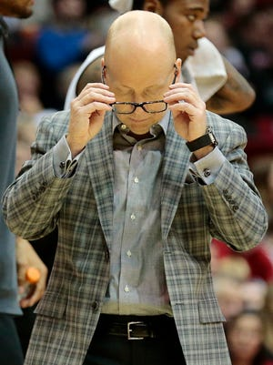 Cincinnati Bearcats head coach Mick Cronin takes off his glasses as he heads to the huddle during the second half of the NCAA mens basketball game between the Cincinnati Bearcats and the East Carolina Pirates at Fifth Third Arena on the campus of the University of Cincinnati on Saturday, Feb. 13, 2016. The Bearcats advanced to 19-7 with a 75-60 win over the Pirates.