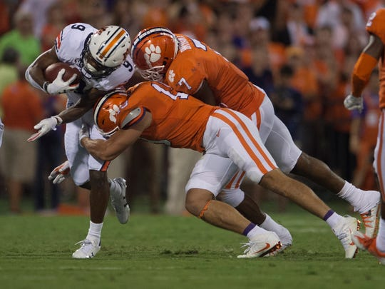 Auburn running back Kam Martin (9) is hit during the NCAA football game between Auburn and Clemson on Saturday, Sept. 9, 2017, in Clemson S.C.