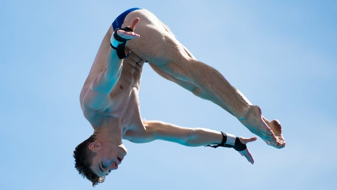 British diver Matty Lee dives in with intense concentration at the FSU Morcom Aquatic Center