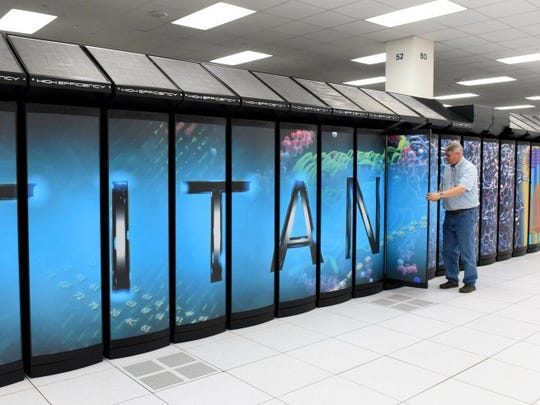 Buddy Bland, director of the Oak Ridge Leadership Computing Facility, shows the Titan supercomputer April 20, 2016, at Oak Ridge National Laboratory.