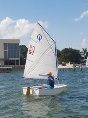 Shae Riley gives the thumbs-up while sailing on the Lake Worth Lagoon during the George Washington Regatta.