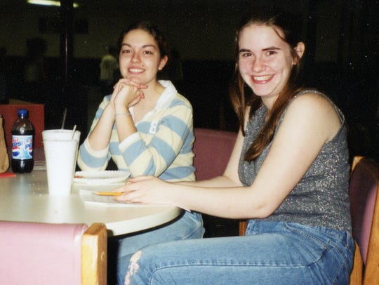 Sarah Flood,left, and Caitlan Coleman sit together