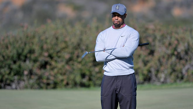 Tiger Woods awaits  his turn on the 12th green during the second round of the Farmers Insurance Open golf tournament at Torrey Pines.