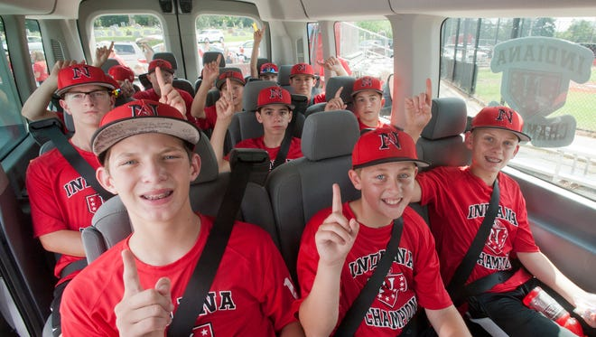 The New Albany Little League majors team (age 11-12) loaded in its van, prepares for the trip to the regional championship in Indianapolis08 Aug 2015