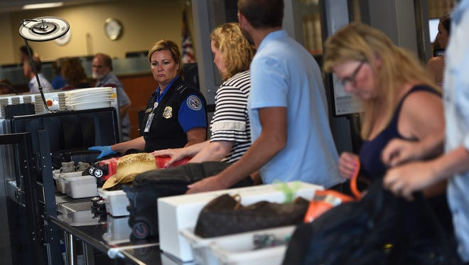 A TSA agent keeps an eye on the security line at the Reno-Tahoe International Airport in Reno.