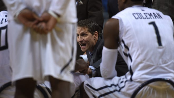 Nevada head coach Eric Musselman instructs his players during a timeout against Santa Clara during their basketball game at Lawlor Events Center in Reno on Dec. 18, 2015.