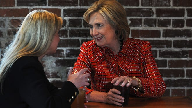 In 2015: Hillary Clinton, right, speaks with Reno Mayor Hillary Schieve at Coffeebar during a campaign visit to Reno on Monday, Nov. 23, 2015