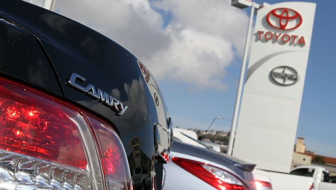 A Toyota Camry sits on the sales lot at City Toyota in Daly City, Calif.