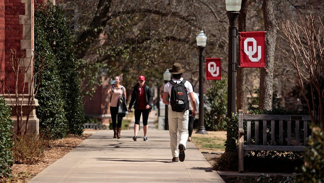 Students walk on campus between classes at the University of Oklahoma on March 2015 in Norman, Oklahoma. The institution is one of several Delaware students can attend for in-state tuition as part of the Academic Common Market.