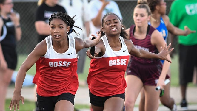 Bosse's Jaden McElroy hands off to teammate Tionne Brigham for the final leg of the 4 x 100 meter relay at the girls track sectional held at Mount Vernon High School Tuesday, May 16, 2017.