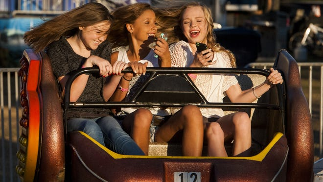 Mallory Cason, from left, Marlee Caldwell and Mataiya Sanders ride at the Autauga County Fair begins in Prattville, Ala. on Tuesday October 11, 2016. The fair runs through Saturday the 15th.