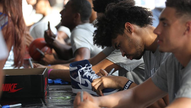 University of Kentucky basketball Nick Richards signs autographs for fans during the teams train tour of Kentucky at a stop in downtown Midway, Kentucky.       June 24, 2018