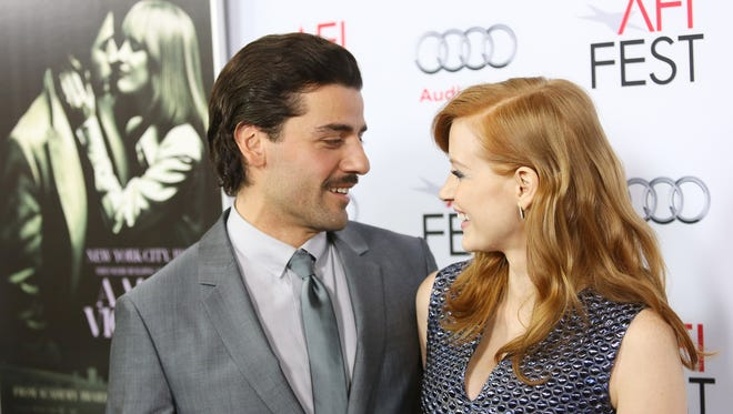 Oscar Isaac and Jessica Chastain arrive at a screening 'A Most Violent Year' on November 6