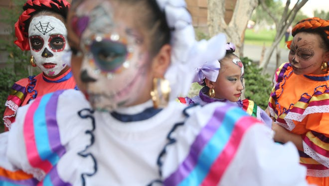"""Ballet Folklorico Sol Del Desierto gets rready to perform during the fourth annual """"Dia De Los Muertos"""" festivities at Desert Memorial Park in Cathedral City on October 29, 2016. The festivities are in honor of those loved ones that have passed on."""
