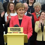 Scotland's First Minister and Leader of the Scottish National Party, Nicola Sturgeon, speaks in front of all the SNP's members of the Scottish Parliament, in front of the Kelpies statues, designed by Scottish artist Andy Scott, in Falkirk, Scotland, on May 7, 2016.