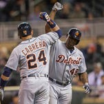 Detroit Tigers right fielder Torii Hunter (48) celebrates with first baseman Miguel Cabrera (24) after hitting a home run in the ninth inning against the Minnesota Twins at Target Field. The Tigers won 8-6.