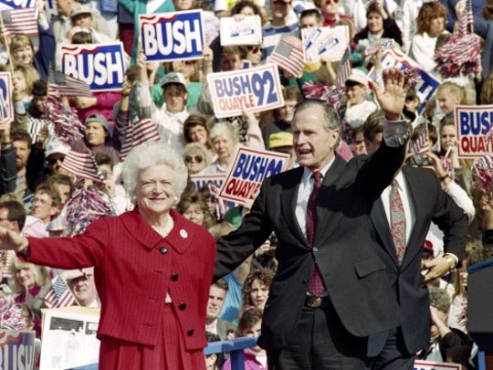 U.S. President George Bush and First Lady Barbara Bush wave to supporters on October 12, 1992 at a campaign rally in Springfield, Pennsylvania. Bush goes on to campaign in Michigan later in the day.