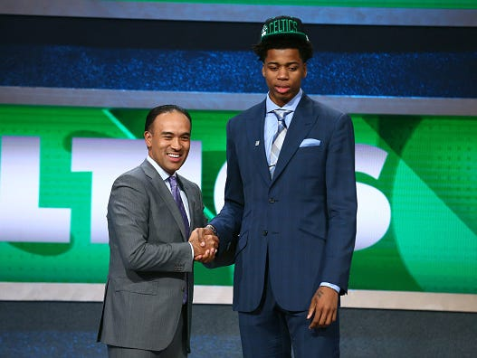 Deyonta Davis shakes hands with NBA Deputy Commissioner and Chief Operating Officer Mark Tatum after being selected by the Boston Celtics - for the Memphis Grizzlies - with the 31st overall pick, the first of the second round.