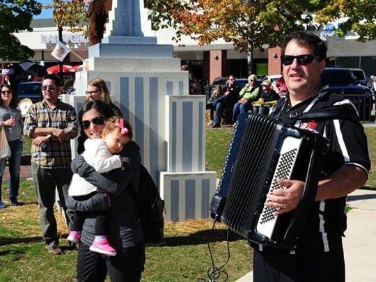 Farmington Hills resident Nina Eltringham dances with her daughter Grace as they are serenaded by Kevin Jakubowicz of the Kielbasa Kings Polka Band.