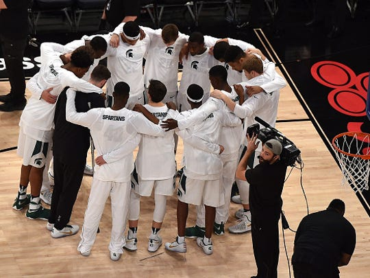 MSU's basketball team huddles prior to their game against