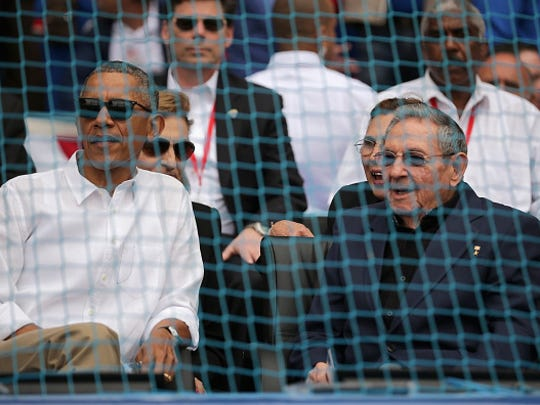 U.S. President Barack Obama (left) and Cuban President Raul Castro talk before the start of an exposition game between the Cuban national team and the Major League Baseball team Tampa Bay Devil Rays at the Estado Latinoamericano March 22, 2016 in Havana, Cuba. This is the first time a sittng president has visited Cuba in 88 years.