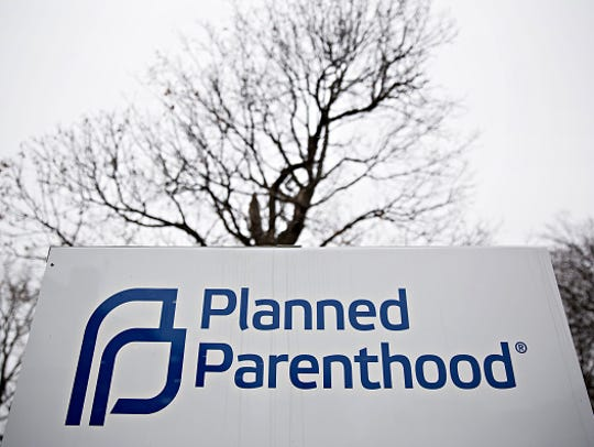 Signage is displayed outside a Planned Parenthood office.