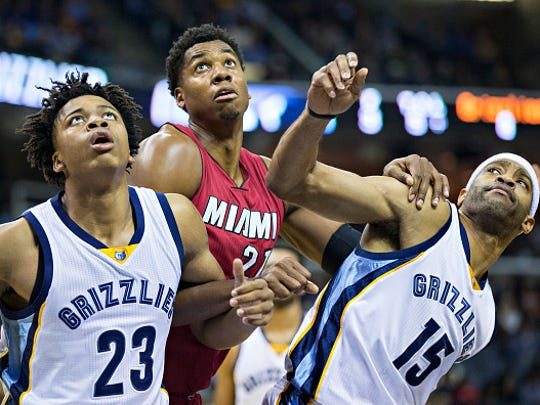 Former MSU standout Deyonta Davis, left, and Memphis Grizzlies teammate Vince Carter block out Miami's Hassan Whiteside for a rebound earlier this season. Carter, who is twice Davis' age, has taken the NBA rookie under his wing.