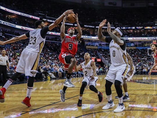 NEW ORLEANS, LA - APRIL 02: Chicago Bulls guard Rajon Rondo (9) has a shot blocked by New Orleans Pelicans forward Anthony Davis (23) during the game between the New Orleans Pelicans and the against the Chicago Bulls on April 2, 2017, at Smoothie King Center in New Orleans, LA.