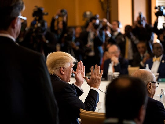 U.S. President Donald Trump gestures during the G7 Summit expanded session in Taormina, Sicily, on May 27.