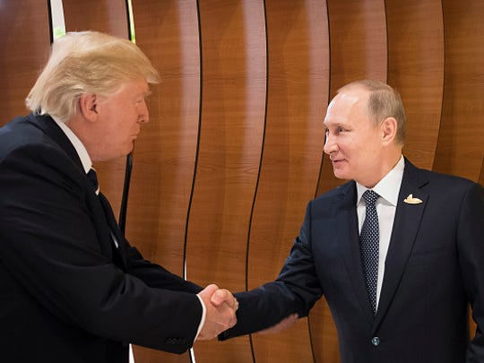 In this photo provided by the German Government Press Office Donald Trump, President of the USA (left), meets Vladimir Putin, President of Russia (right), at the opening of the G20 summit on July 7, 2017 in Hamburg, Germany.