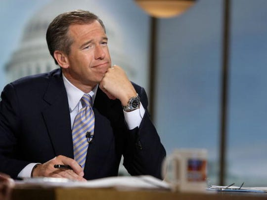"WASHINGTON - JUNE 22:  Moderator Brian Williams watches a video which pays tribute to late moderator Tim Russert during a taping of ""Meet the Press"" at the NBC studios June 22, 2008 in Washington, DC. Williams announced that former Nightly News anchor Tom Brokaw would temporarily host the show through the presidential elections in November, 2008.  (Photo by Alex Wong/Getty Images for Meet the Press)"