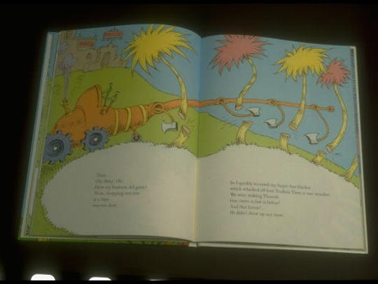 Pages of Dr. Seuss's children's book re saving trees,