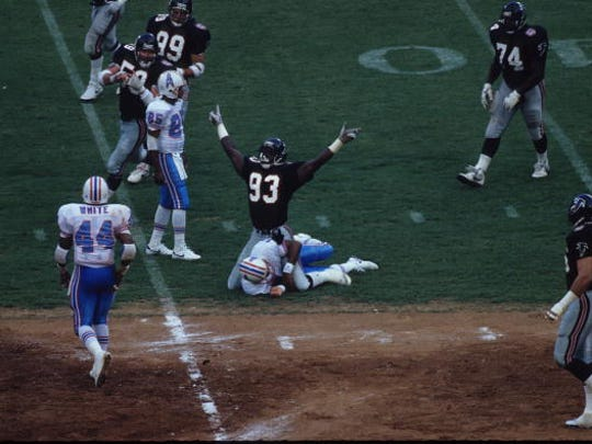 Linebacker Aundray Bruce #93 of the Atlanta Falcons celebrates after sacking quarterback Warren Moon #1 of the Houston Oilers in Atlanta Fulton-County Stadium on September 9, 1990 in Atlanta, Georgia. The Falcons defeated the Oilers 47-27.