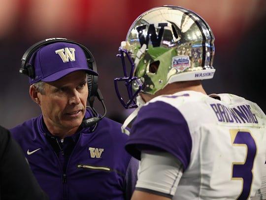 Washington coach Chris Petersen talks to quarterback Jake Browning during the Fiesta Bowl on December 30, 2017 in Glendale, Arizona.