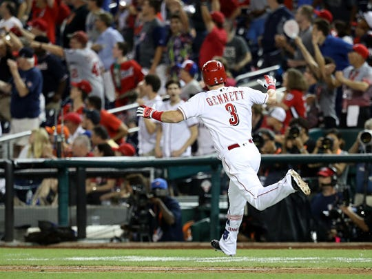 Scooter Gennett of the Cincinnati Reds and National League celebrates after a two-run home run in the ninth inning to tie the game against the American League during the 89th MLB All-Star Game, presented by Mastercard at Nationals Park on July 17, 2018 in Washington, DC.