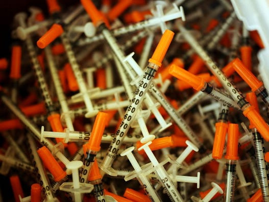 Used syringes are discarded at a needle exchange clinic where users can pick up new syringes and other clean items for those dependent on heroin on Feb. 6, in St. Johnsbury, Vt.