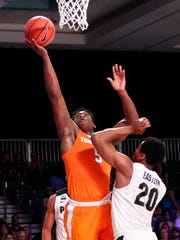 Nov 22, 2017;  Paradise Island, BAHAMAS; Tennessee Volunteers forward Admiral Schofield (5) shoots as Purdue Boilermakers guard Nojel Eastern (20) defends during the first half in the 2017 Battle 4 Atlantis in Imperial Arena at the Atlantis Resort. Mandatory Credit: Kevin Jairaj-USA TODAY Sports