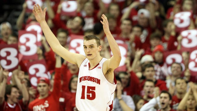 Wisconsin Badgers forward Sam Dekker (15) pumps up Wisconsin fans near the end of the game with the Indiana Hoosiers at the Kohl Center. Wisconsin defeated Indiana 69-58.