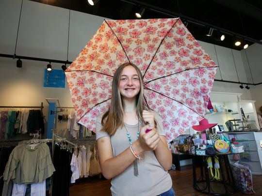 Cameron Breier, 12, modeled upcoming fashion trends, including an umbrella, for back to school provided by Fresh Boutique 4 Girls.July 24, 2018