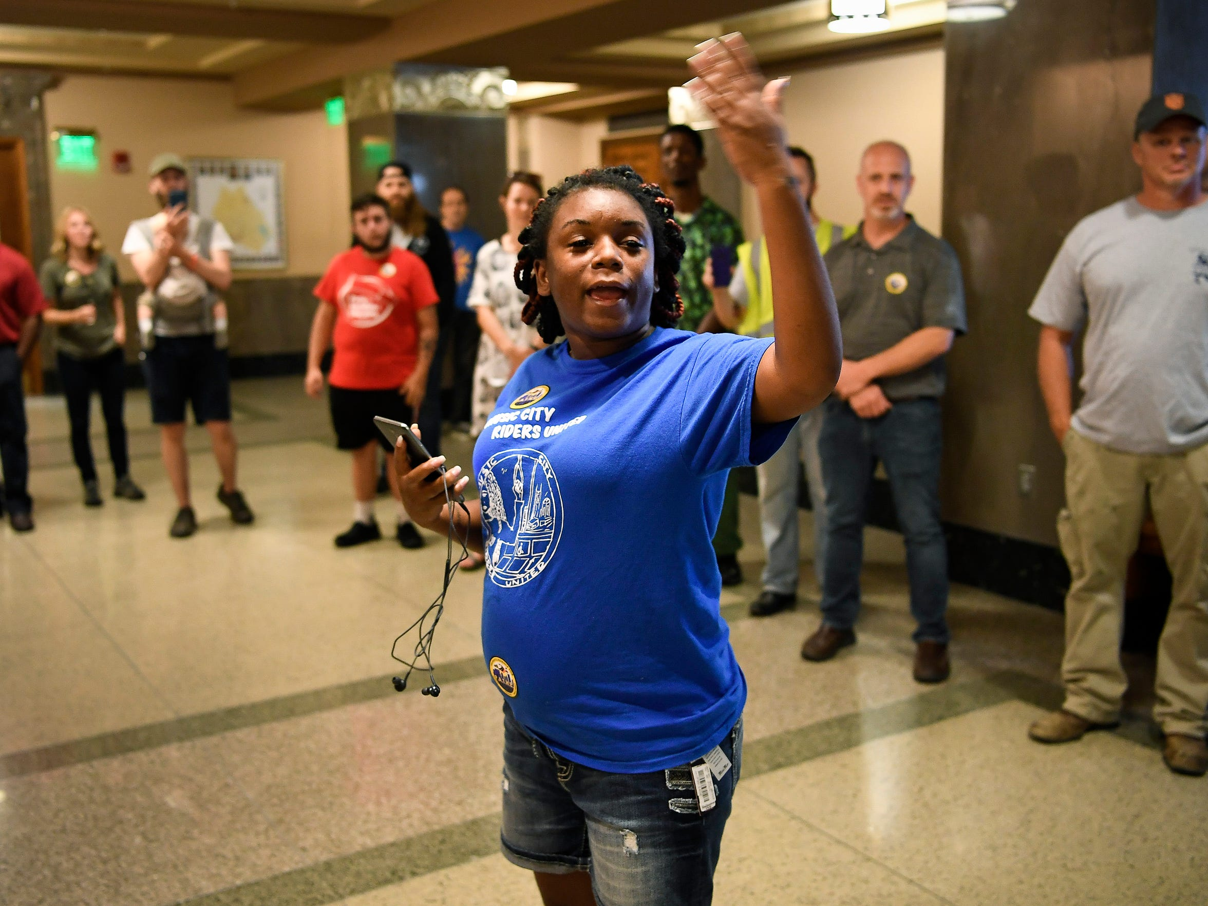 Kutonia Smith-Bond leads a march and rally for equitable public transportation Tuesday, Sept. 19, 2017, at the Metro Courthouse. Smith-Bond, who rides the bus nearly every day, is considering moving to Crossville, about 115 miles east of Nashville, because of the cost of living.