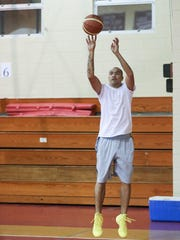Francis Benitez practices free throws during basketball practice for the Filipino Sports Association of Guam Basketball League All-Star team held at St. John's gymnasium on July 18.