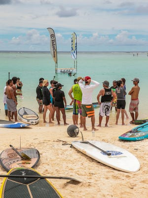 Competitors attend a briefing prior to a race a last year's SUP Fest.